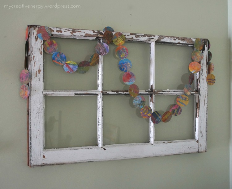 Paper garland on an antique window